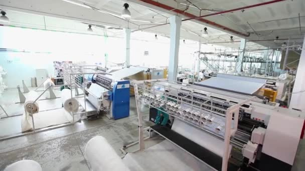 depositphotos_180116232-stock-video-textile-factory-textile-industry-warping